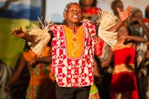 One of Watoto's young men in the spotlight. (Photo/ashbrookeMEDIA/Flickr)