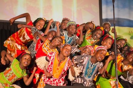 Watoto children singing and dancing. (Photo/ashbrookeMEDIA/Flickr)